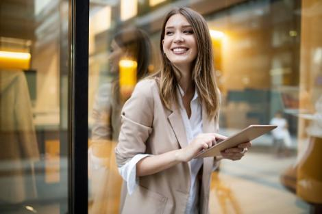 Remote working women with tablet in the street Carrier